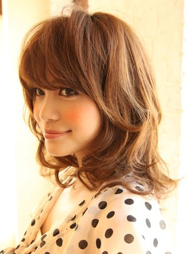 cute shoulder length hair w/ medium length layers for a little extra volume. and heavy bang.