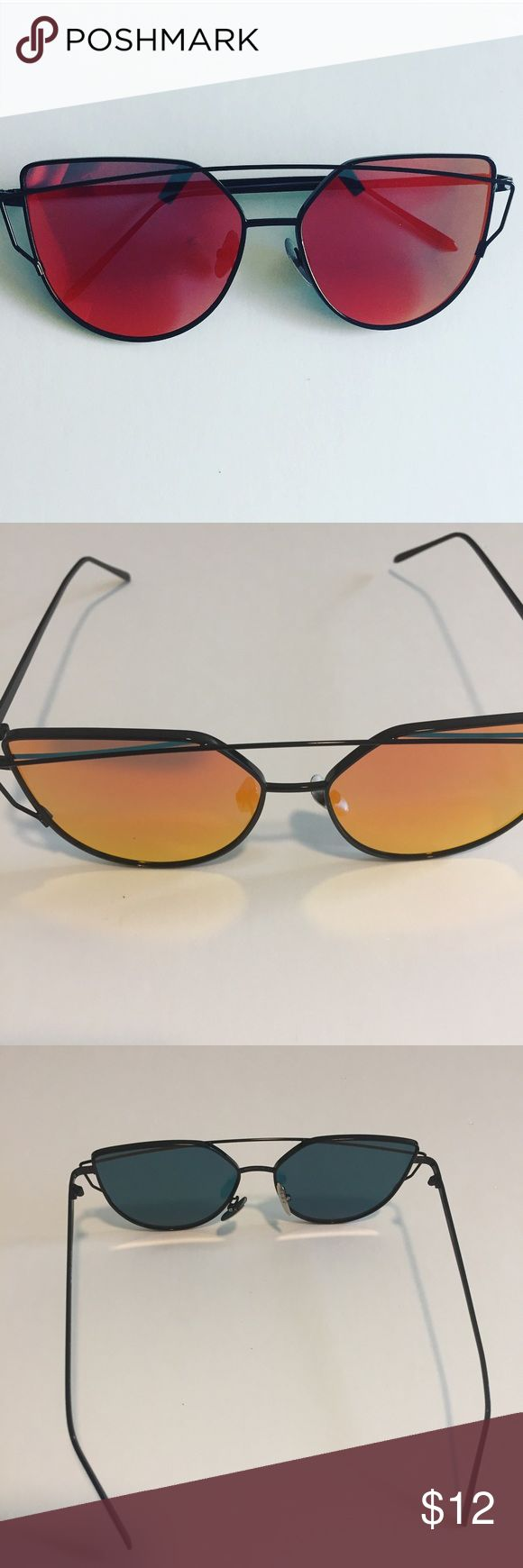 Red-Orange Cateye Metal Frame Mirrored Sunglasses New boutique item, Red-Orange Cateye Metal Frame Mirrored Sunglasses. In some light they mirror a red color (first picture), other lighting makes them look orange (second picture). I have other colors available for sale in my closet also- blue, Rose Gold, gold and silver Accessories Sunglasses