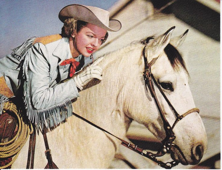 | Dale Evans Wife of Roy Rogers and Buttermilk Quarter Horse used in their TV show.
