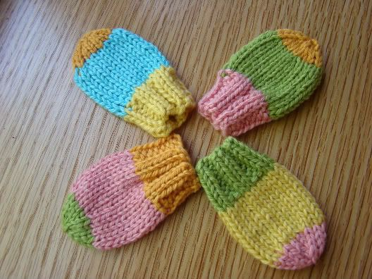 Knit Baby Mitts :)  (simple, cute, and quick!  5g per mitt and about 30 min for a novice knitter.  Fit perfectly!)