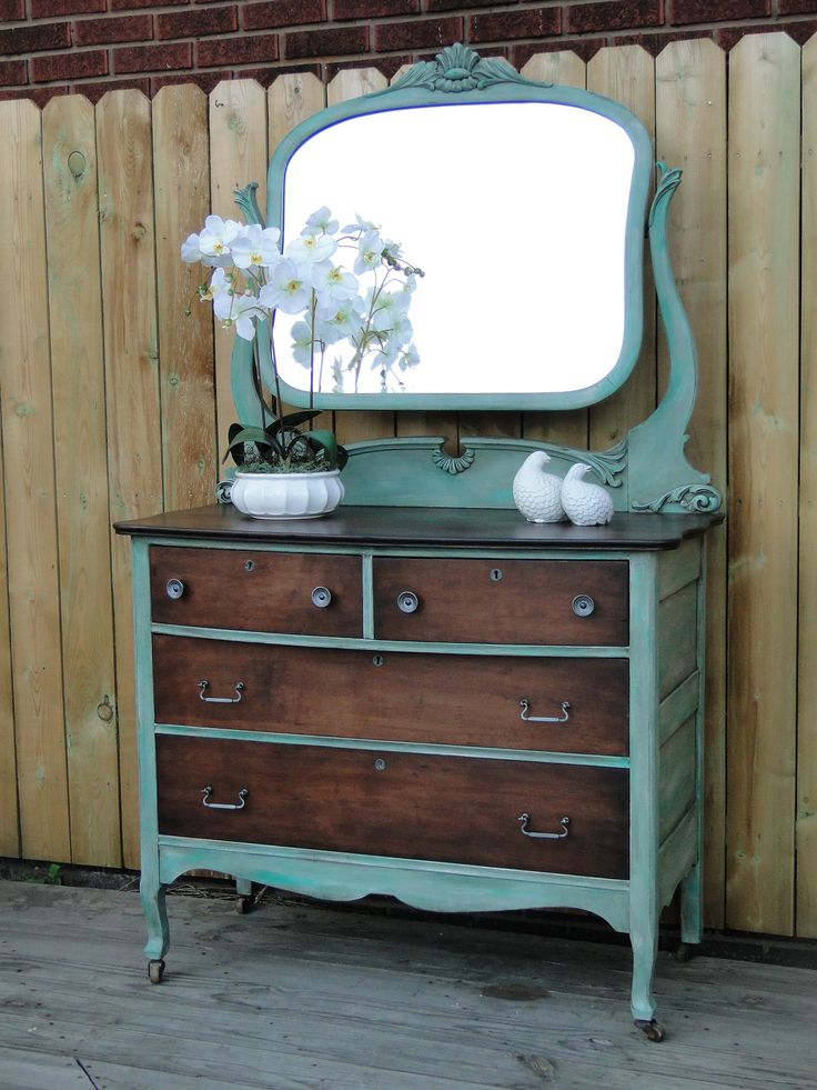I tried a new technique on this dresser to get the variegated green that is painted on the body and mirror. I really like how it turned out but I do think it looks better in person. The top and drawer fronts have been dark stained and even that was variegated a bit to keep a time worn look. This dresser is very, very old and there is a bit of discoloration in the mirror but it has so many pretty details that you might not mind:) Modern Vintage