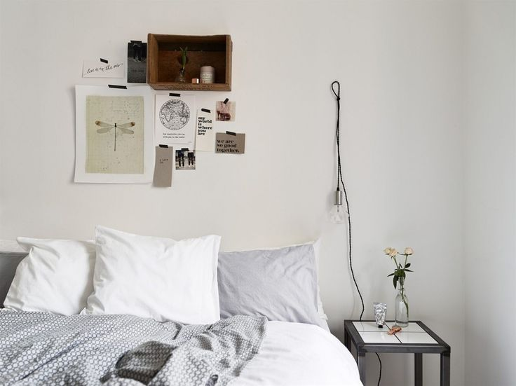 """Full of personality, this scrapbook/shelving arrangement complements the DIY aesthetic of the room and accompanies the hanging bulb light fixture perfectly. Framed pictures are non-existent but instead, a quick fix of inspirational imagery taped to the wall is the ultimate effortless decorative feature."""