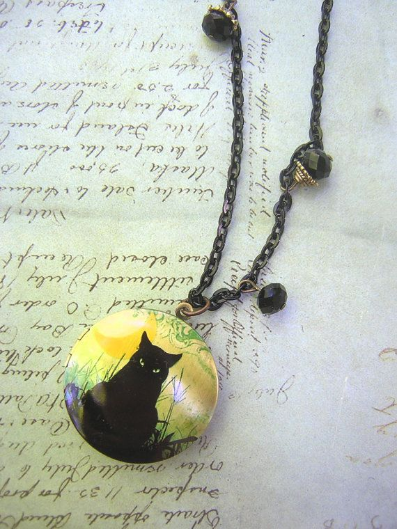 Moody and mystical black cat locket on an 18 black chain accented with black matte crystals.  The locket itself is brass with an bronze color and