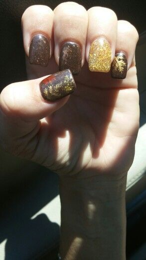 Chocolate glitter with gold accent nail and fall leaf design