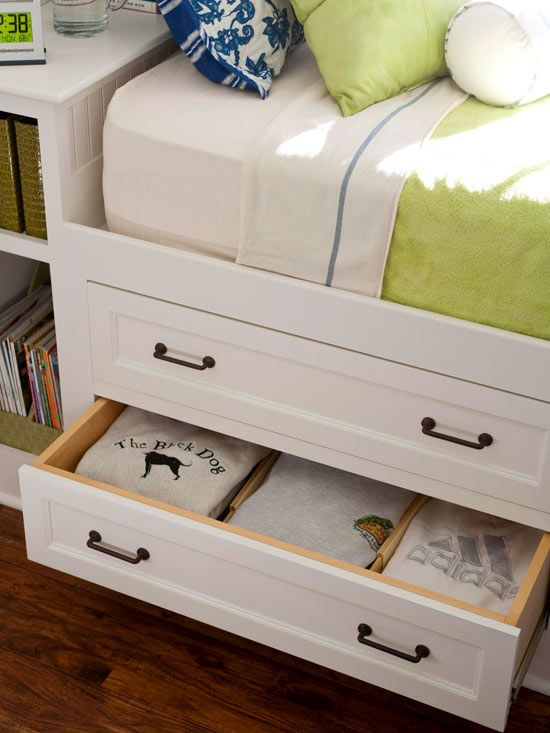 A nightstand-headboard at one end of the bed packs extra storage under the eaves, while four drawers built into the base of the bed store folded clothes and shoes without taking up additional floor space