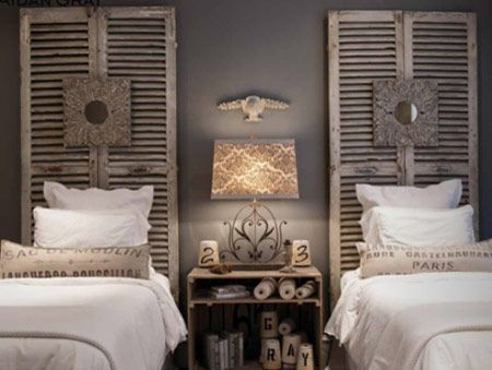 Shutters standing in for headboards on matching twin beds with lovely accessories