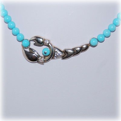 Turquoise beads necklace with a sterling silver lobster and zirgonia. Entirely handmade in our workshop.