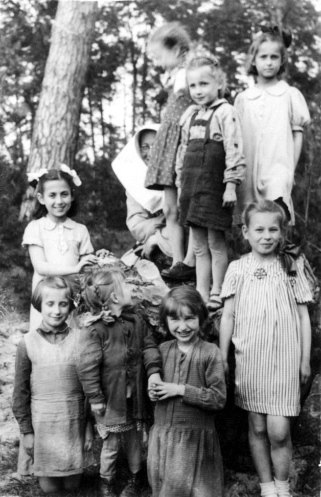 """In 1939, right after the Germans invaded, Warsaw began to see trainloads of blonde, blue-eyed children being taken to ""Germanization"" camps in Germany.  Everyone in Warsaw knew about a certain group of women...when the trains pulled in, they tried to convince the German guards to accept bribes in exchange for some of the children.""  Irena Sendler was one of these women.  Later she did everything she could to save Jewish children, including the ones in this photo. (1944)"