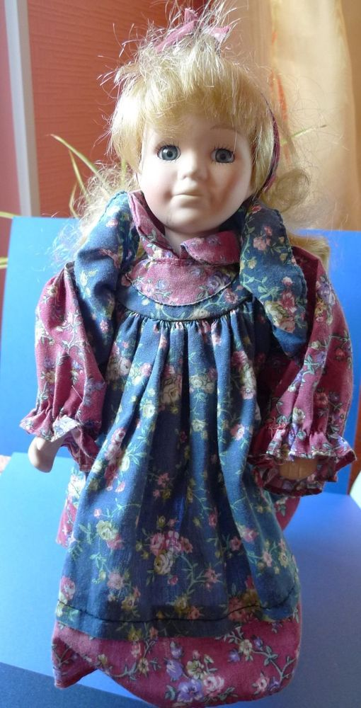 Vintage Porcelain Girl Doll Toy on a metal pedestal stand from collection 12in.