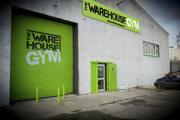 Exterior Graphics for warehouse gym - Roller shutters branding and signs for budget gym - Vinyl Impression  http://www.vinylimpression.co.uk/