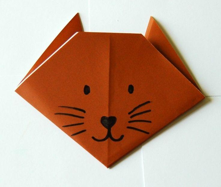 origami animaux en forme de tête de chat - on retourne la figurine origami et on dessine des yeux, des moustaches et un nez