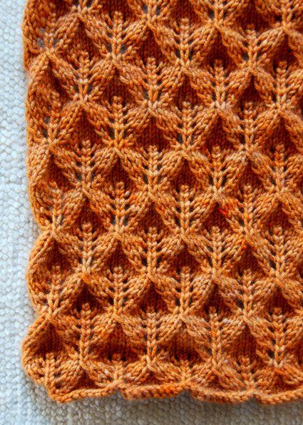 "This Lovely Leaf Lace scarf is made with Lobster Pot's 8-ply cashmere in color ""Chatham Light"". The stitches that create this beautiful and dimensional pattern are a simple combination of strategic yarn-overs and decreases. The lace pattern has a wonderful dimensionality while the stockinette pattern curls around your neck like a big soft hug."