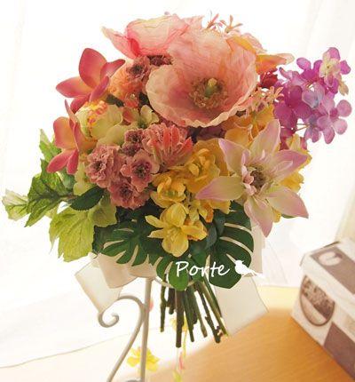 珊瑚色のクラッチブーケ ウェディングブーケ・花冠・通販専門店「ぽると」