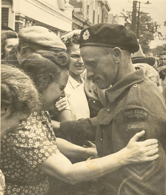 a mother welcoming her son home from war. The Elgin Regiment of Canada. Canadian Forces WWll