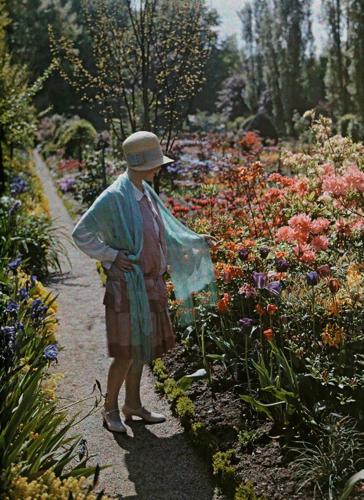 autochrome photography. A young woman admires flowers in a Baden garden in Germany, June 1928. PHOTOGRAPH BY WILHELM TOBIEN, NATIONAL GEOGRAPHIC