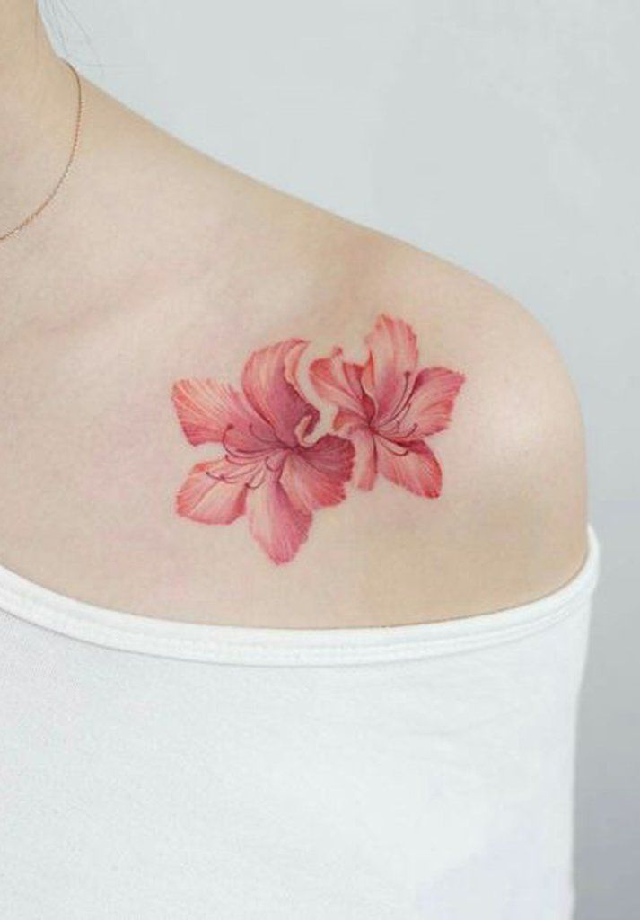 Unique Beautiful Coral Orange Lily Floral Flower Shoulder Tattoo Ideas For Women Www Mybodiart Com Tatt Hibiscus Tattoo Shoulder Tattoo Flower Wrist Tattoos
