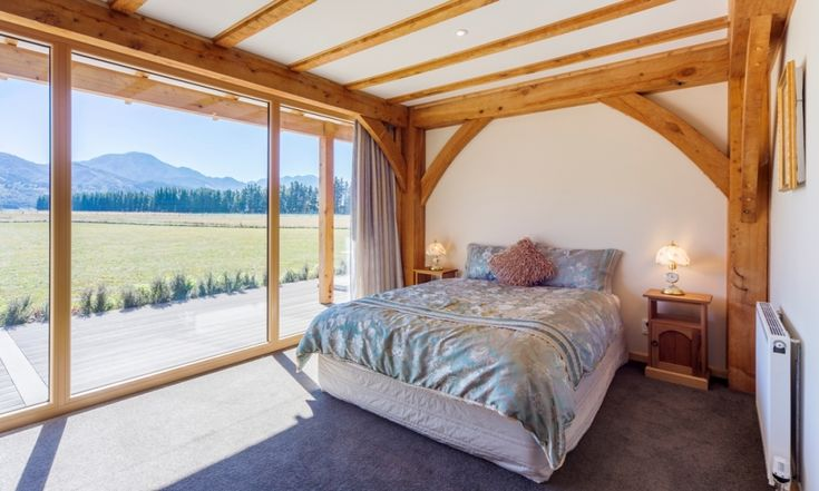 A simple bedroom but oh so much more appealing for the addition of some exposed timbers.