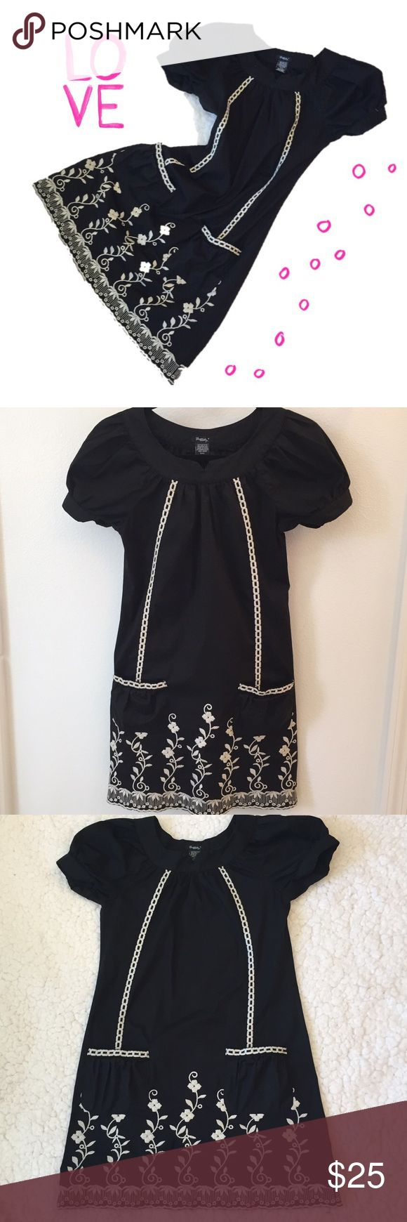 """Casual, embroidered little black dress 💋 A perfect little black dress for a casual look.  It has beautiful embroidery all around the bottom and the top side of pocket.  Tag Size: Small.  Measurements: Chest 33"""".  Hips: 37"""" Length 32 1/2"""".  Arm opening 10"""".  Throw on a pair of white converse and you're off!  💋 No trades please ❣️ no model ❣️Thanks  for stopping by 🤗 Rhapsody Dresses Midi"""