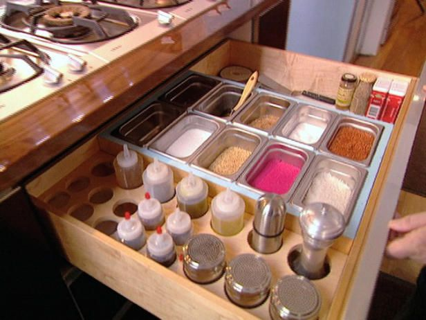 Custom spice drawer under cooktop to keep the most used spices handy.