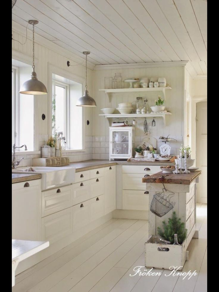 Love the planked ceiling, open shelving & esp the small, narrow island