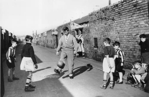 Bobby Charlton in the back streets of Ashington  {a bit north of Tyneside and, tragically, the great Bobby Charlton spent his career not with Newcastle United but with Manchester United]