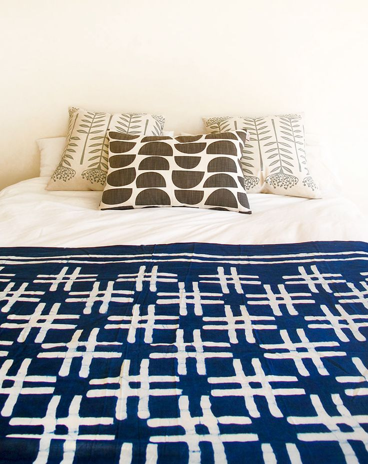 The hand printed 'Weft' scarf by Skinny laMinx looks fantastic as a bed throw.