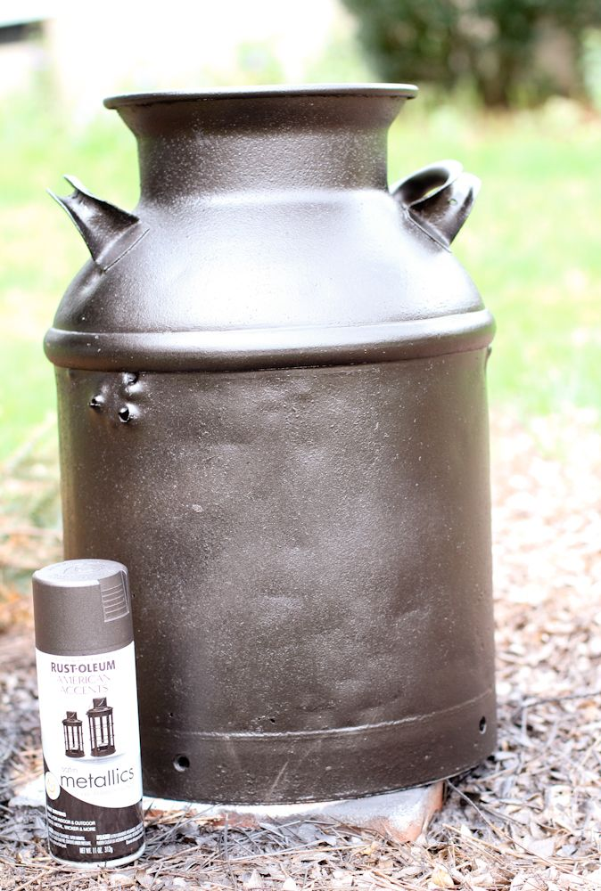 Refurbishing my old milk can and paint our initial on it.  Sit it on from porch with some flowers on top