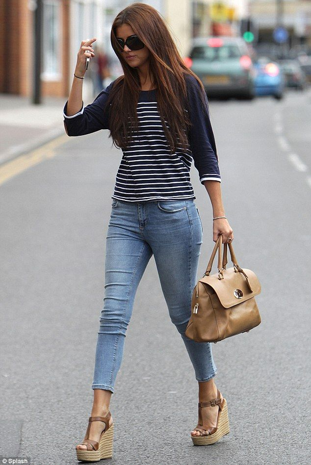 Walk this way: Lucy Mecklenburgh's hair looked superb down as she hid behind sunglasses, but her outfit was casual by her standards