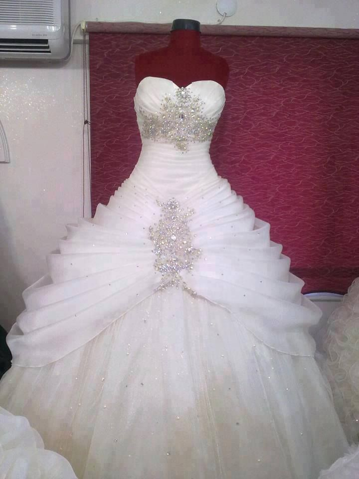 Way too much bling going on here but the idea of the ruffles at the top and a flow to the bottom looks wonderful.