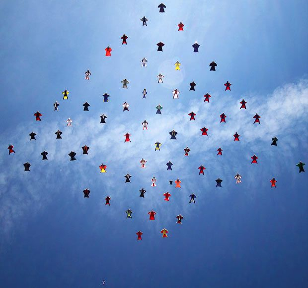 A team of skydivers complete a 70-person formation wearing wingsuits. The team of daredevils came together at Lake Elsinore in California to attempt the world record-breaking stunt...