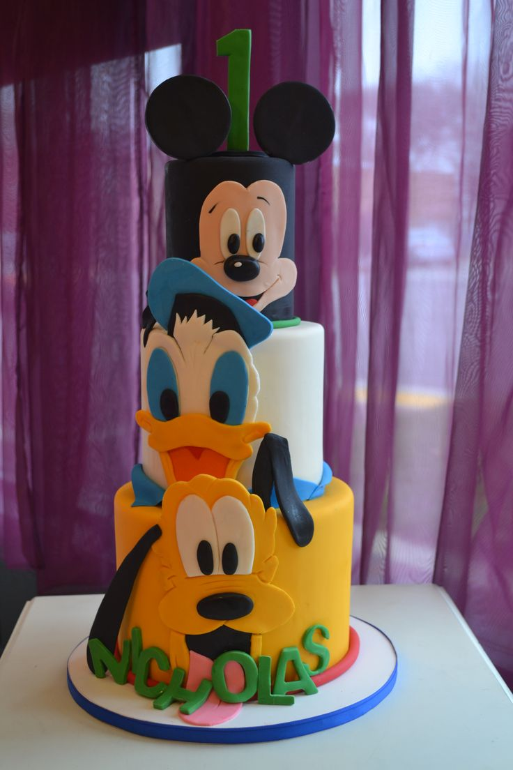 DISNEY Mickey and friends cake  This would be simple to make the fondant cutouts. Simply print out an image of each character and then cut out each colour as a separate piece. Trace over fondant!