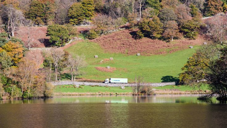 Joe Dunckley posted a photo:  Ambleside, England, UK - November 11, 2016: A Cooperative supermarket delivery lorry passes autumn colours at Rydal Water lake on the rural A591 road in Cumbria's Lake District National Park.