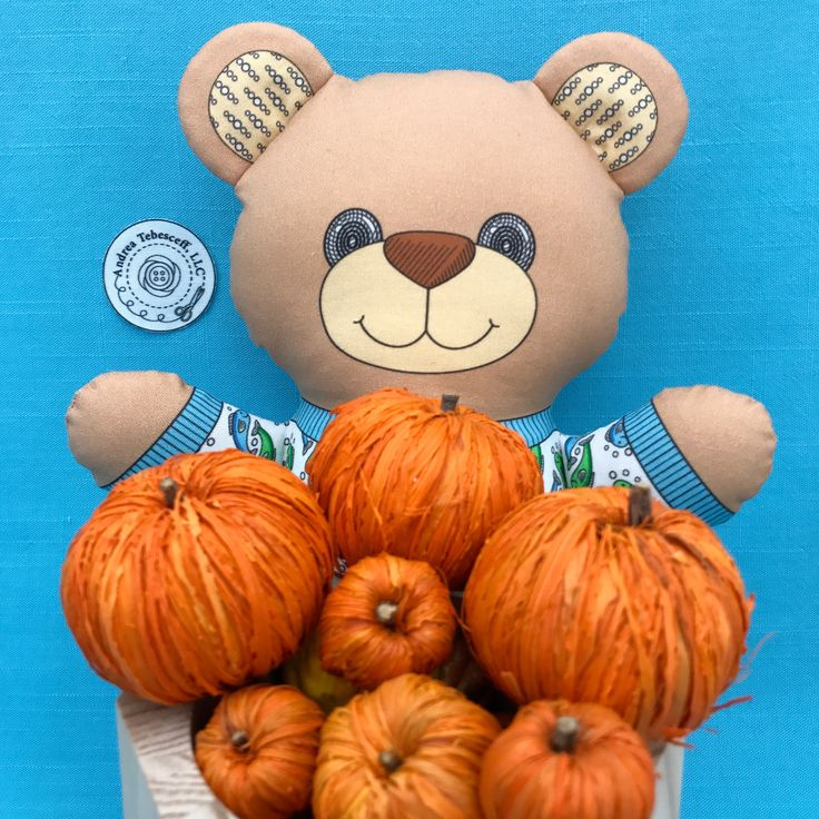 """Bear in Pajamas"" is gathering raffia pumpkins from my stash. I love the colors and textures. It is fun exploring my hidden treasures. ""Bear in Pajamas"" is a Cut and Sew fabric panel that is available in my Spoonflower shop. Link in Profile."