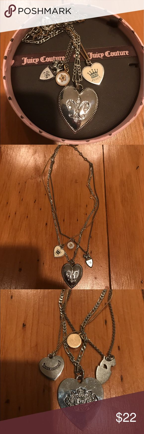 Juicy Couture Silver Fleur De Lis Charm Necklace This beautiful, 3-chain necklace by Juicy Couture features a prominent heart-shaped charm with a rhinestone fleur de lis logo. The chains are of different styles and thicknesses, and one chain is gold while the others are silver. The third photo shows the backside of each of the 4 charms. Comes in original box! Juicy Couture Jewelry Necklaces