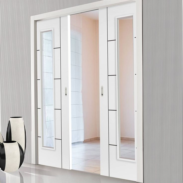 Double Pocket Eco Linea Satin White sliding door system in three sizes with Clear Glass. #moderndoors #glazeddoors #internalpocketdoors