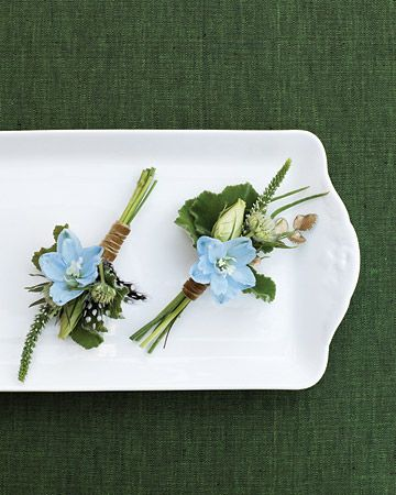 Boutonnieres    Light-blue delphinium, lisianthus buds, geranium foliage, veronica tips, and button ferns make up the boutonnieres.