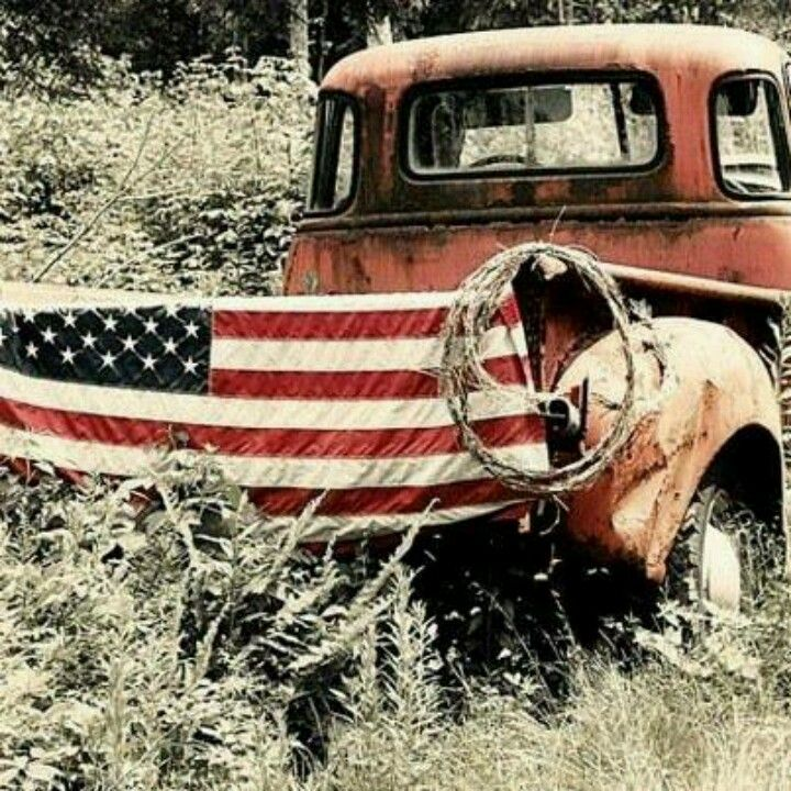 Love this old red truck with the U.S. flag draped across the back.....definitely country thru and thru!