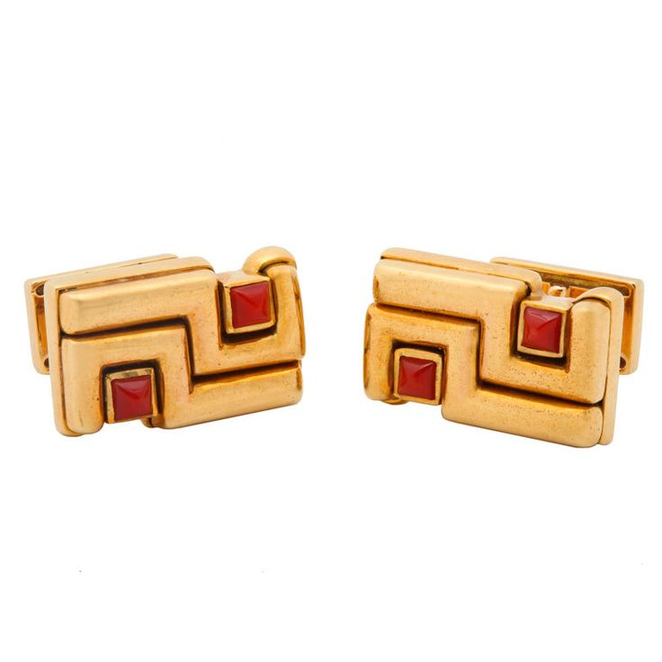 CARTIER - ALDO CIPULLO Gold and Carnelian Cuff Links - Cartier cufflinks by Aldo Cipullo in 18kt gold set with pyramid cabochons of carnelian. Each marked Aldo Cipullo 1972 and registration numbers. One marked Cartier, the other marked Italy. 1/2 inch x 7/8 inch. 33 grams. Made in Italy, Circa 1972. -  Gallery 47, New York