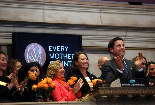 Christy Turlington Photos - Model Christy Turlington (center) and employees of the non-profit organization Every Mother Counts ring the closing bell of the New York Stock Exchange on April 29, 2016 in New York City. The Dow Jones Industrial Average closed down over 100 points. - Dow Jones Industrial Average Closes Down Over 100 Points
