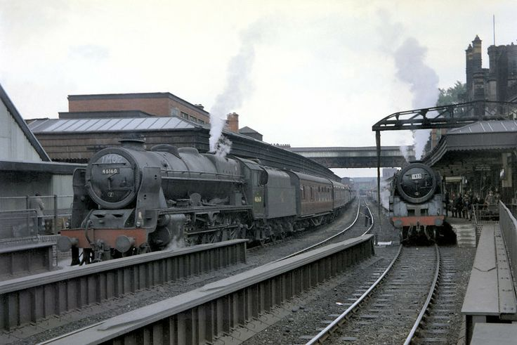 This shot was self-evidently taken at Shrewsbury and almost certainly in 1965 but can a viewer date it precisly because there are plenty of clues? On the left of the shot is rebuilt Royal Scot no. 46160 Queen Victoria's Rifleman whose nameplates have been removed. The shed plate is 12A Carlisle Kingmoor and chalked on the smokebox door is '1M02'. The loco on the right is an unidentified BR Standard 7MT Britannia pacific with excursion code '1M85'.
