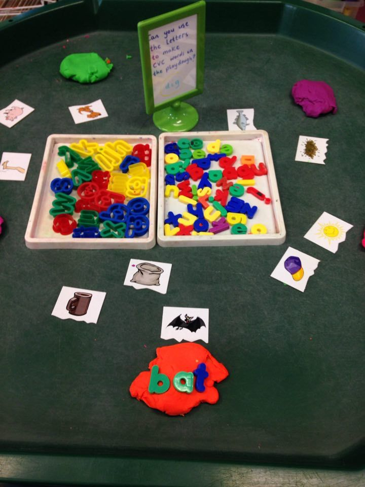 phonics themed tuff spot in continuous provision. use the magnetic letter to make CVC words to match the picture