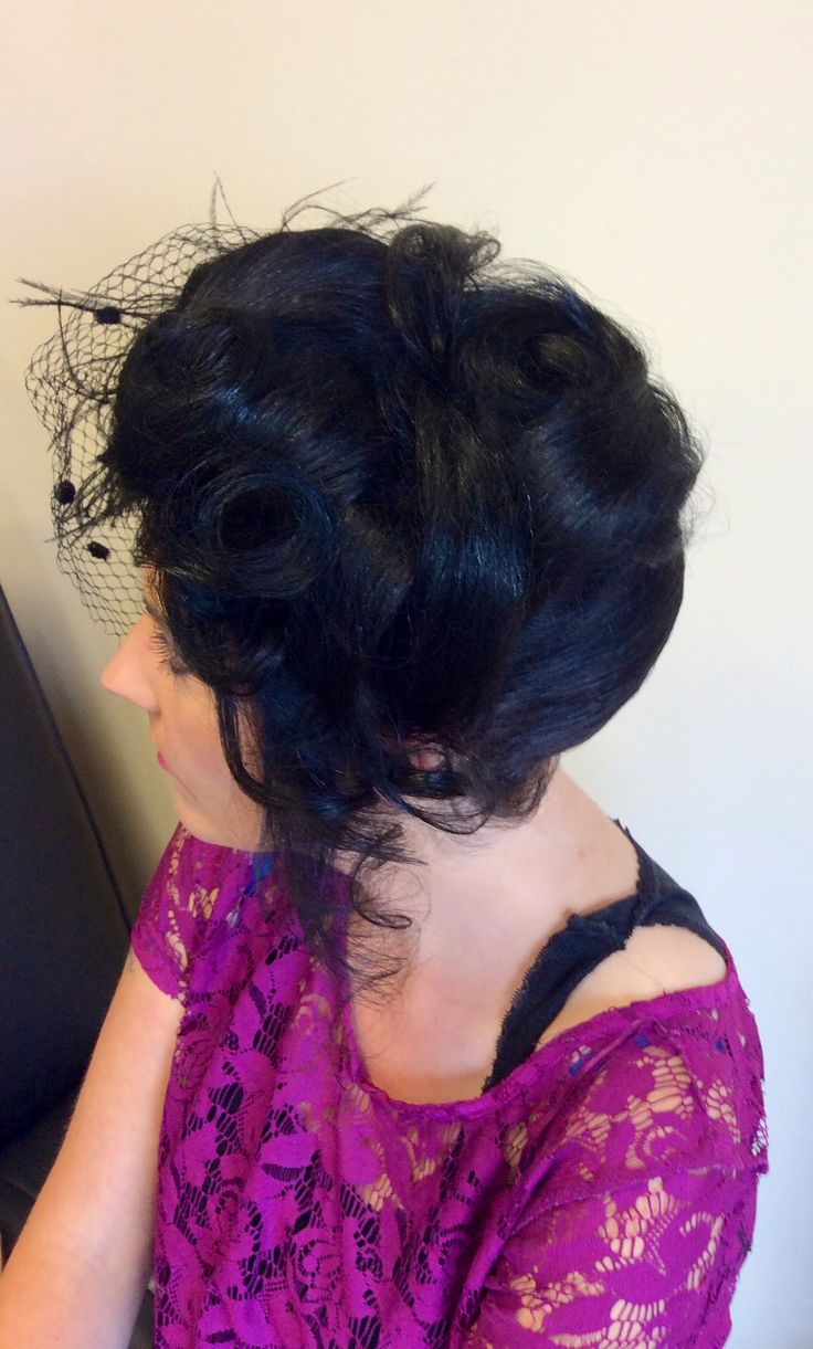 Twisted updo with falling curls