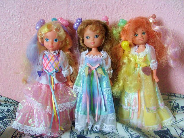 Lady Lovely Locks.  I played with these so much that the iridescent fabric wore off!  you would clip locks to her hair and on the top were squirrels.  I think it was a cartoon too.