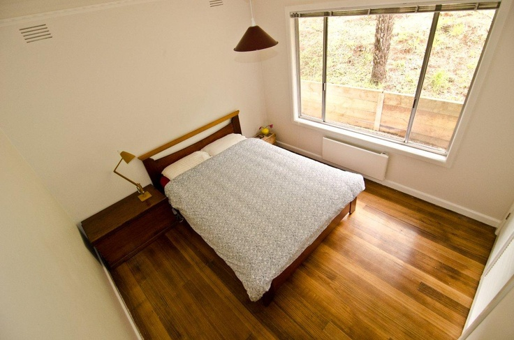 The 2nd bedroom with garden views and built-in wardrobe.