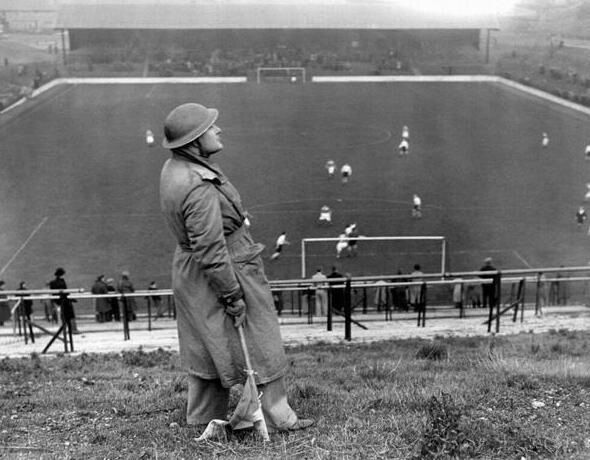 Spotter looking for German air raids during Charlton v Arsenal match circa 1940 London