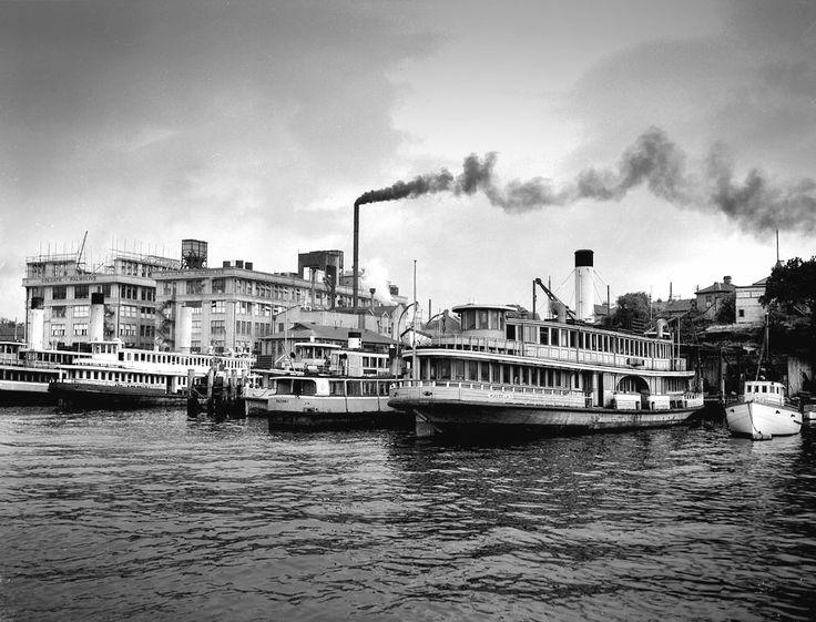 Sydney Ferries Ltd (Kareela ferry) berthed at Harbour locations shows Colgate Palmolive buildings, Balmain. Max Dupain photo, c 1955.