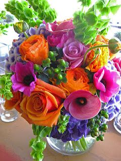 Vase of brightly colored flowers. Now, wouldn't that make anyone smile?!