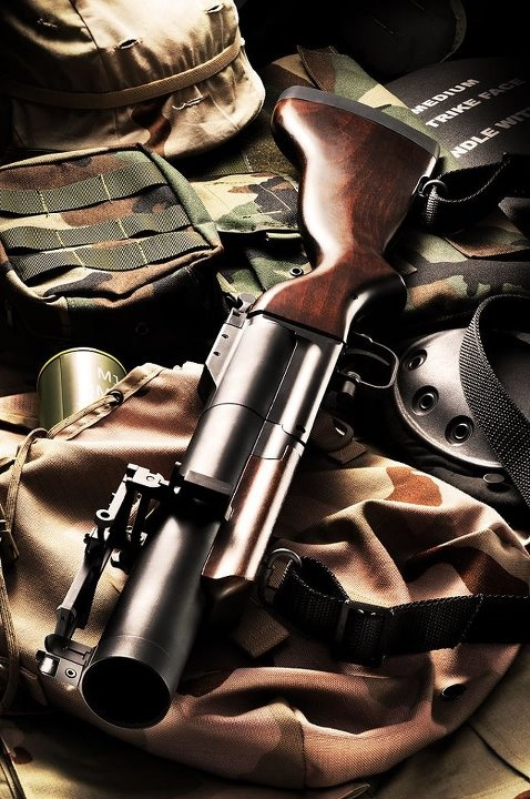"M79 grenade launcher AKA ""Blooper"" in the US and ""Wombat Gun"" in Oz - fires a wide variety of 40 mm rounds, including explosive, smoke, anti-personnel, CS gas, flechette and illumination"