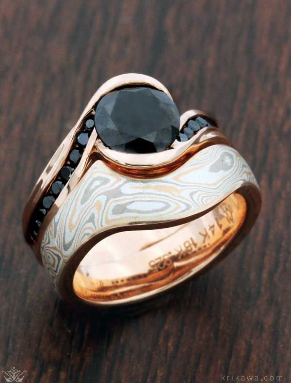 Customized in the metal, mokume and stones you love, this bridal set features our Carved Wave Engagement Ring in 14k rose gold and black diamonds with a Contoured Mokume Wedding Band in Champagne Mokume and a 14k rose gold liner. How will you customize your set?