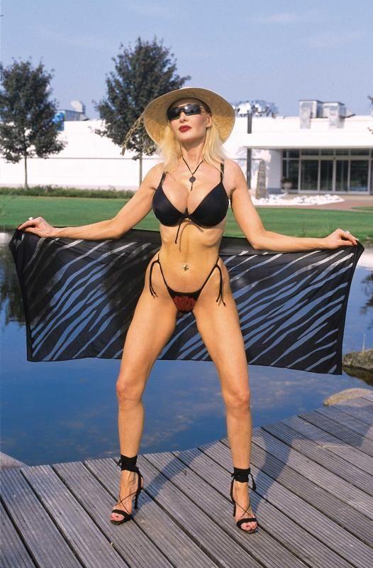 Danni ashe orange bikini for the big boobs lovers - 1 part 10